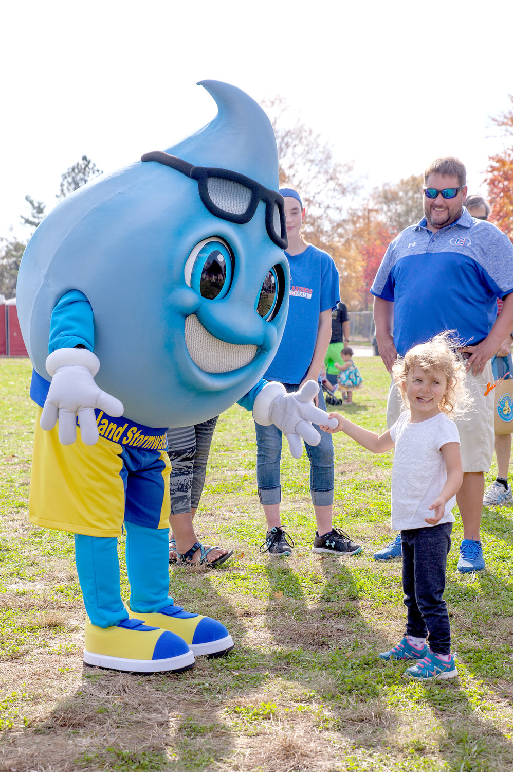 CLEVELAND STORMWATER MASCOT, Ben Rainin, left, make a new friend, Mary Maxwell, during Sunday's event.