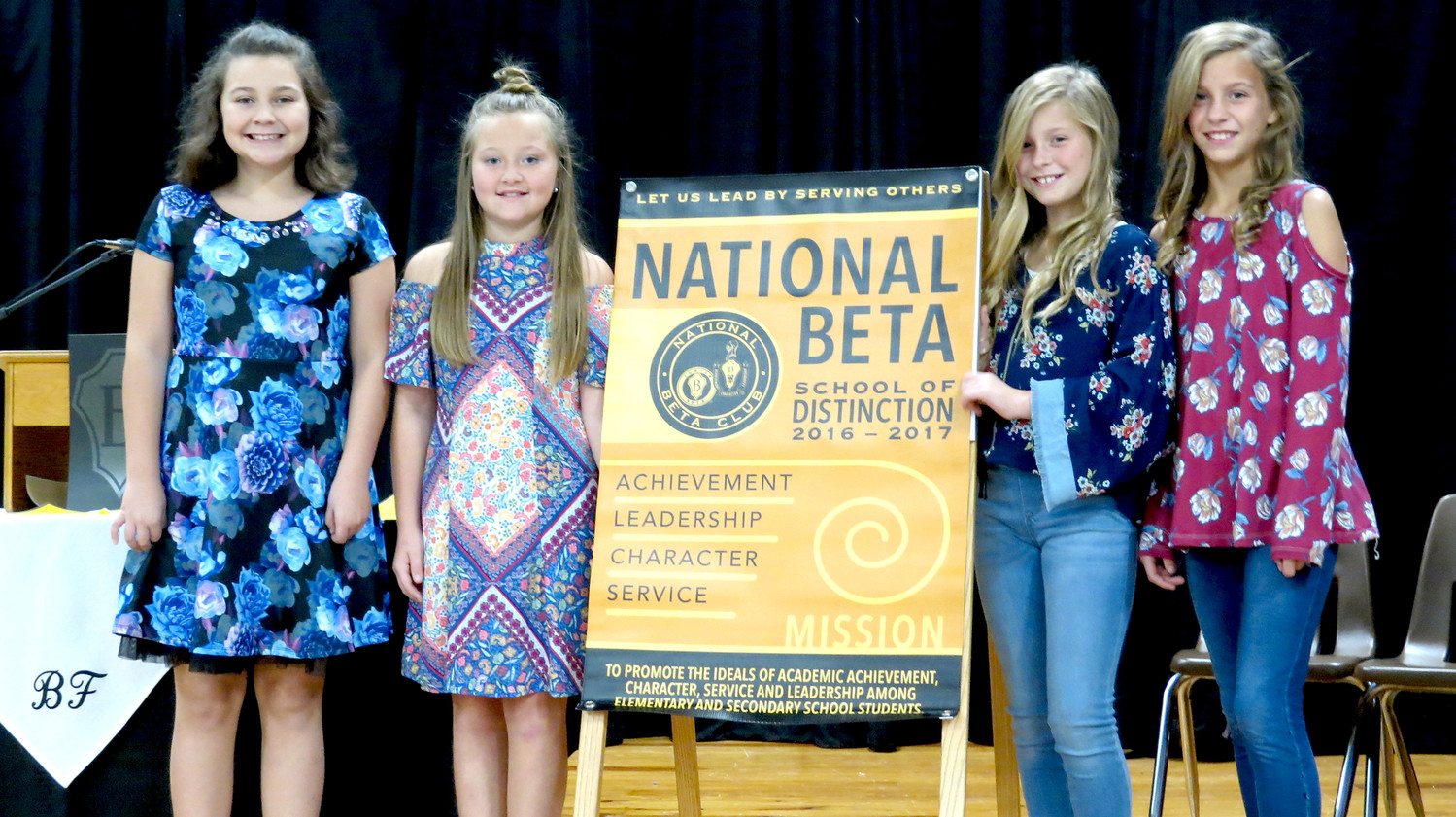 BLACK FOX ELEMENTARY'S Junior Beta Club earned the national Beta organization's Distinguished School Award for the second year in a row. Seen here with the award are the club's officers for the 2017-18 year: President Emma McMahan, Vice President Hannah Pearson, Secretary Keelyn Eslinger and Chaplain Madelyn Eslinger. The club is sponsored by school curriculum coach Amber Winters.