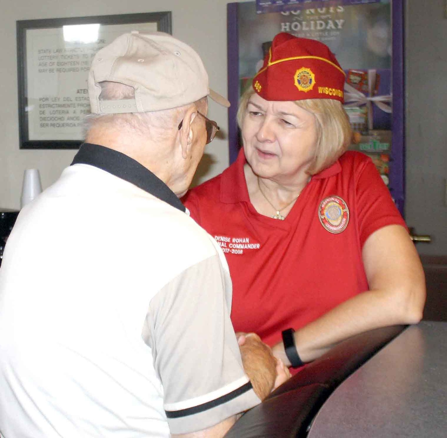AMERICAN LEGION National Commander Denis Rohan, right, said she enjoyed talking with Bradley County's lone living Pearl Harbor survivor, George Allen, during her visit to Cleveland's Post 81 Tuesday.