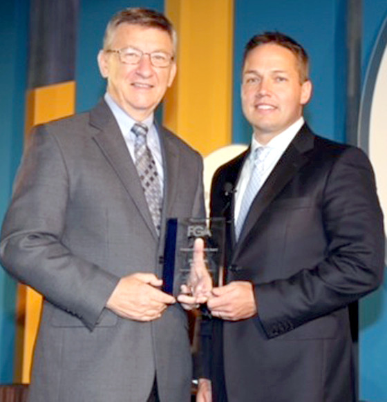 STATE REP. DAN HOWELL, left, receives a national award for his legislation to combat welfare fraud in Tennessee. Presenting the honor is Tarren Bragdon, president and CEO of the Foundation for Government Accountability.