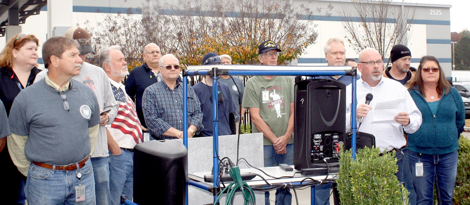 WHIRLPOOL CLEVELAND Plant Manager Dicky Walters, with microphone at the right, coordinated a noon program and cookout Thursday, to pay tribute to the plant's 51 veterans. The Bradley County Funeral Honor Guard also attended.