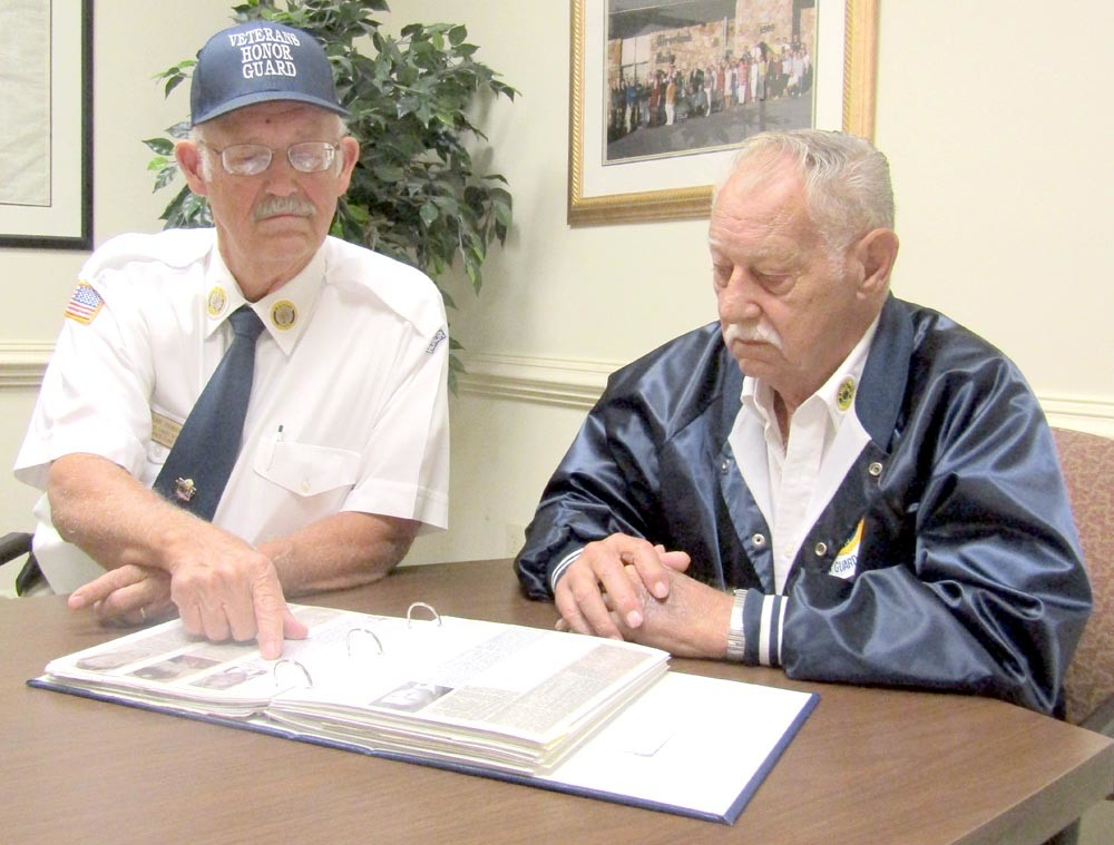 FUNERAL HONOR GUARD members John Thomason and Roy Smith look back at some of the many veterans who they've helped honor over the years.