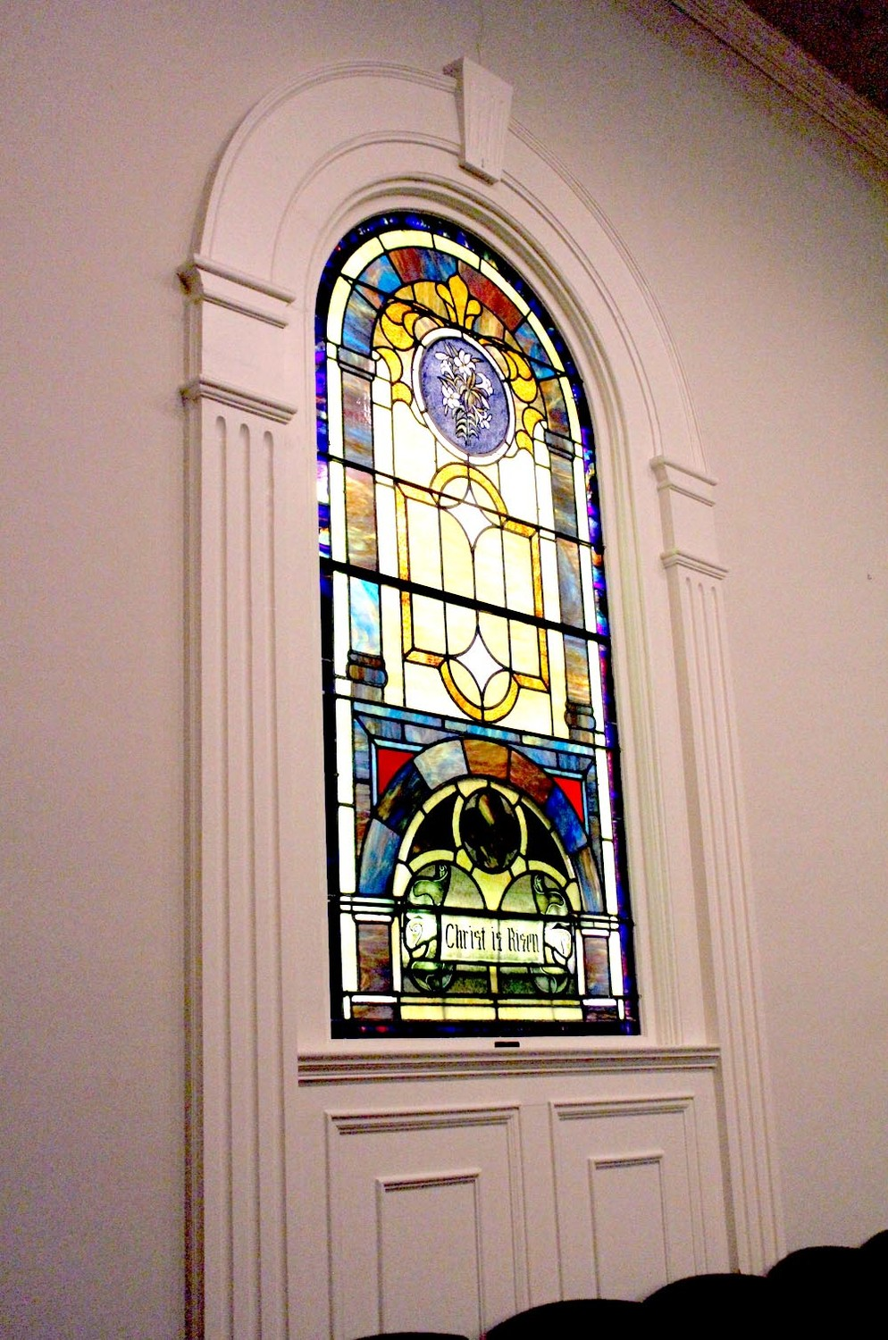 THIS STAINED GLASS hangs in the choir area of the church.