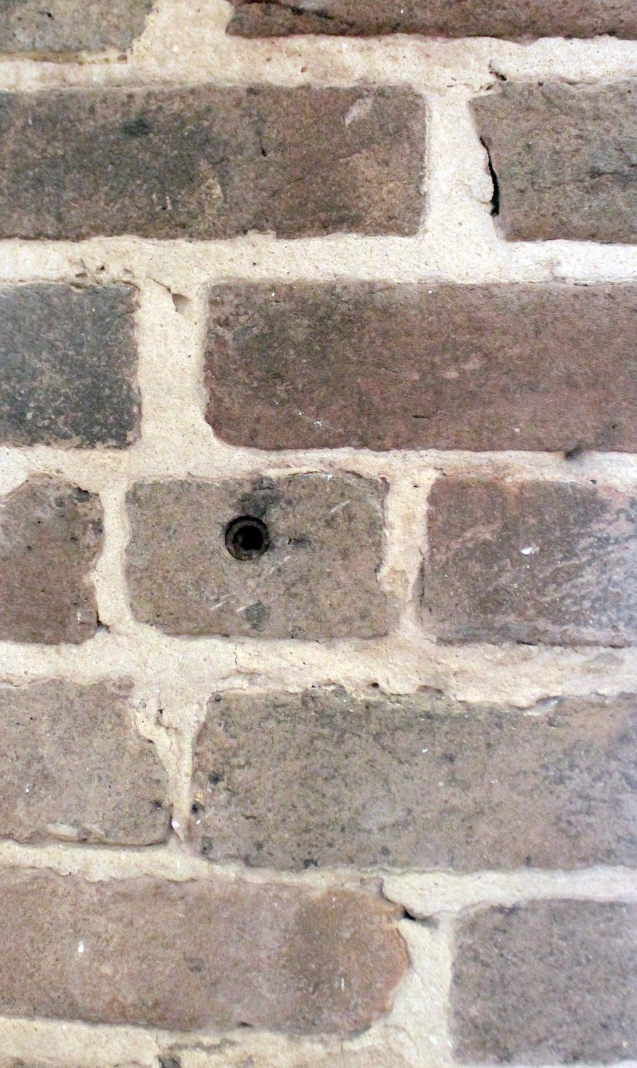 THIS BULLET HOLE in the brick wall of the Presbyterian Church was from the Civil War .