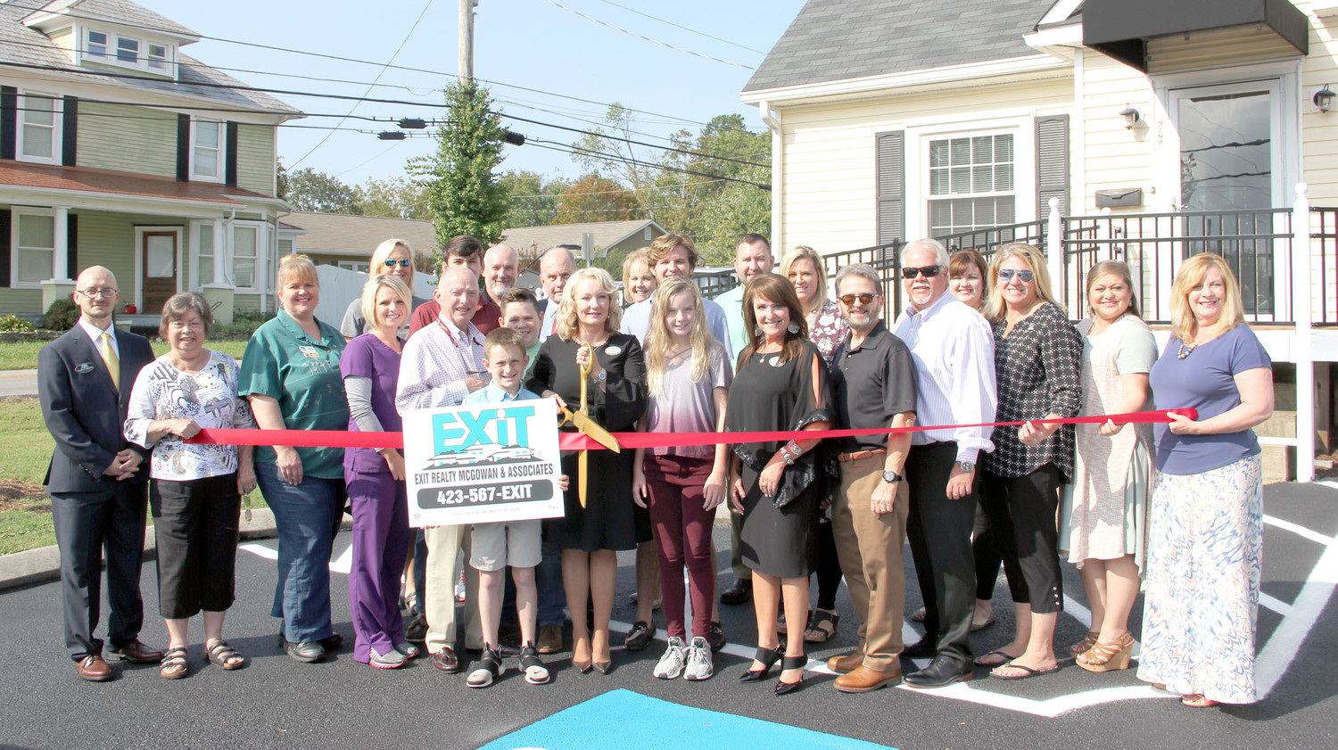 THE CLEVELAND/BRADLEY Chamber of Commerce recently held a ribbon cutting for Exit Realty. Above, cutting the ribbon, is Patricia McGowan, owner. Also, pictured above are family members, Mayor Tom Rowland, Chamber staff and ambassadors. Exit Realty recently opened its doors to the community at 2025 Chambliss Ave. The firm provides experienced realty professionals that assist you when buying or selling property. These knowledgeable professionals are trained in specialties such as negotiation and market trends. If you are in the market, contact Exit Realty at 423-567-3948 or visit their new location.