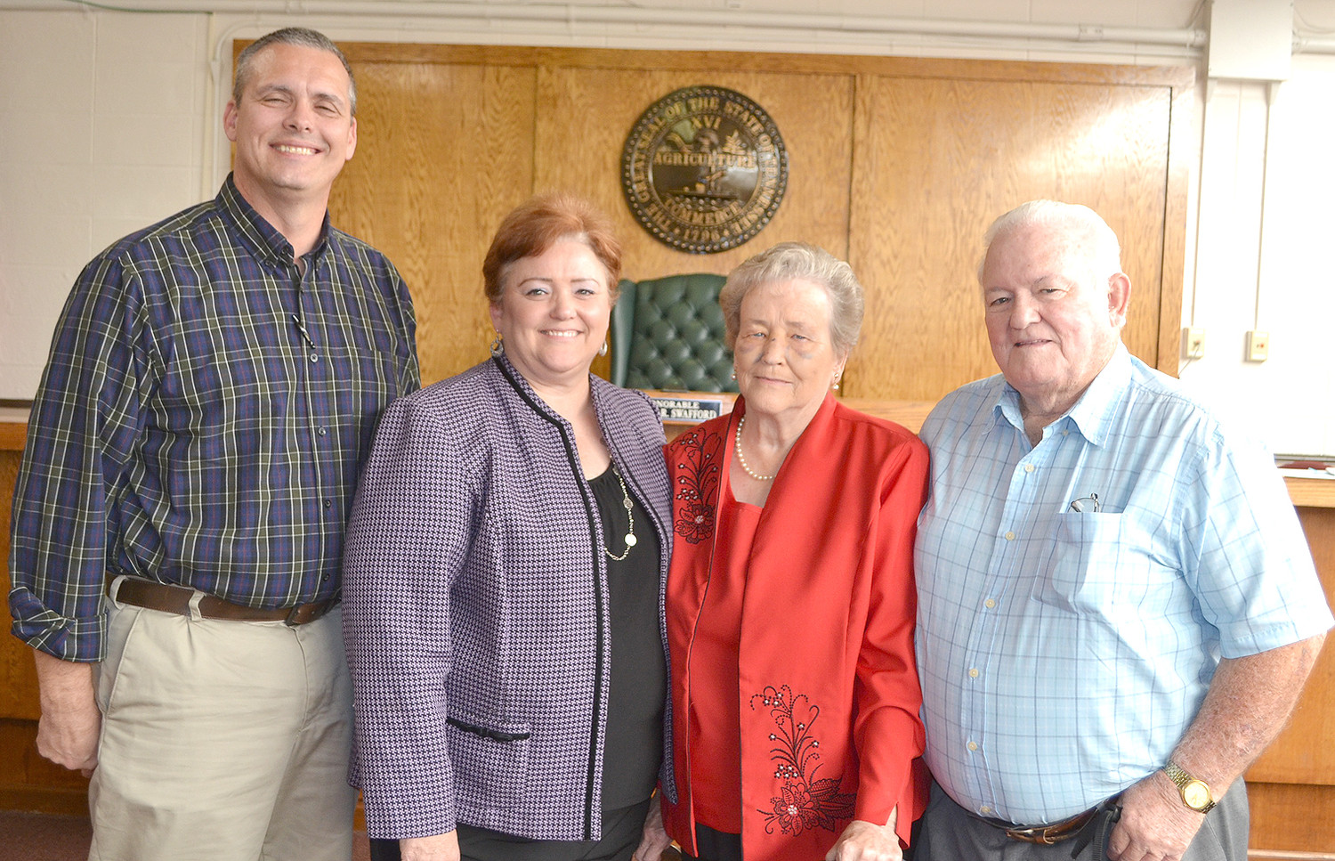 VICKIE TOWNE was sworn-in as the new Juvenile Court director, and her parents were able to attend the ceremony. From left are Doug Towne, Vickie Towne, and her parents, Judy and Arvel Thomasson.