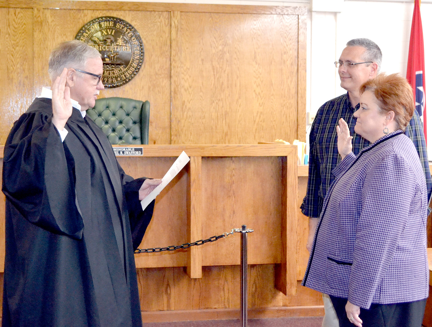 VICKIE TOWNE was recently sworn-in by Juvenile Court Judge Dan Swafford, left, as the new Bradley County Juvenile Court director. With Towne is her husband, Doug.