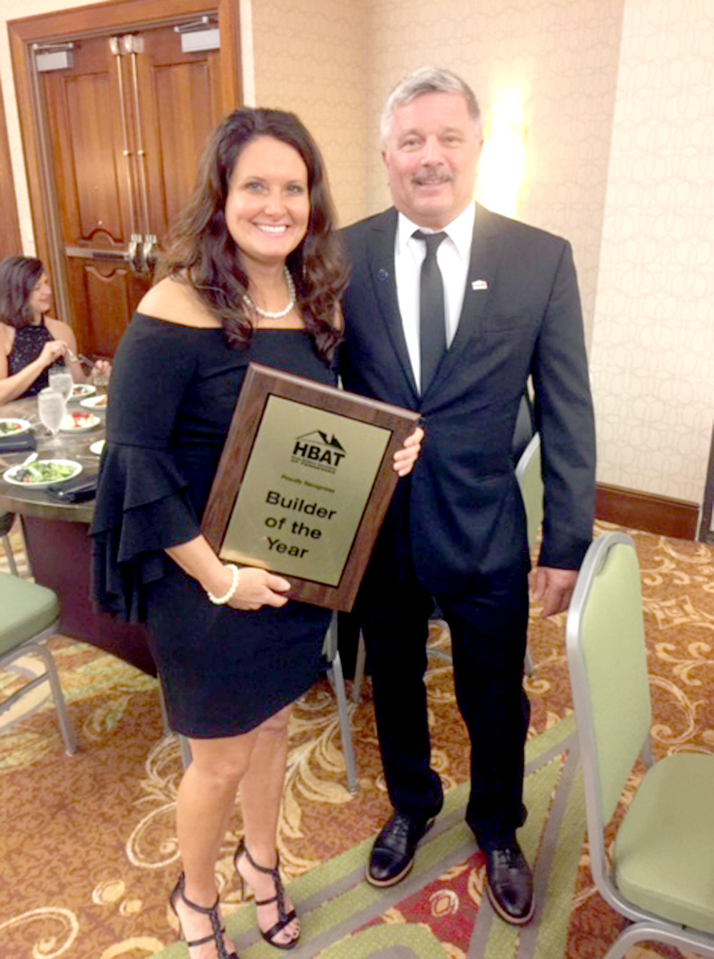 CHARLOTTE PEAK accepts her state Builder of the Year award from Home Builders of Tennessee President Dennis Epperson.