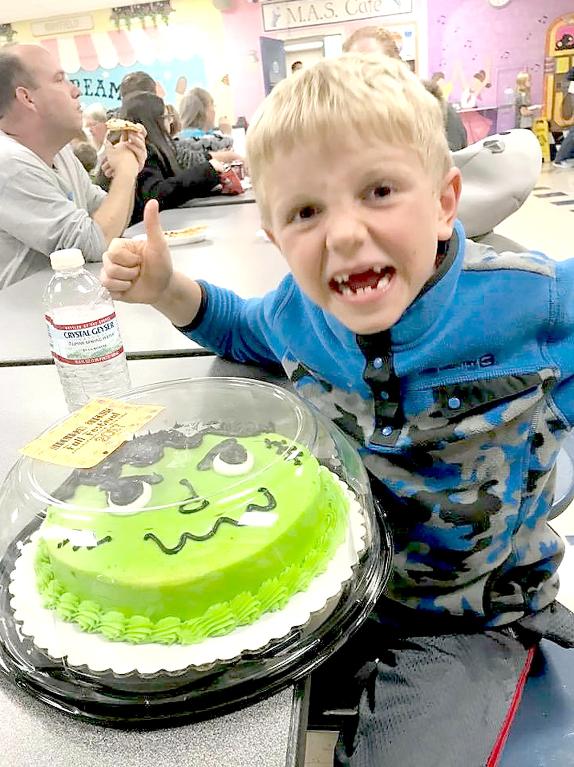 JAKE NELSON celebrates winning a cake at the cake walk during the Michigan Avenue Elementary School Fall Festival.