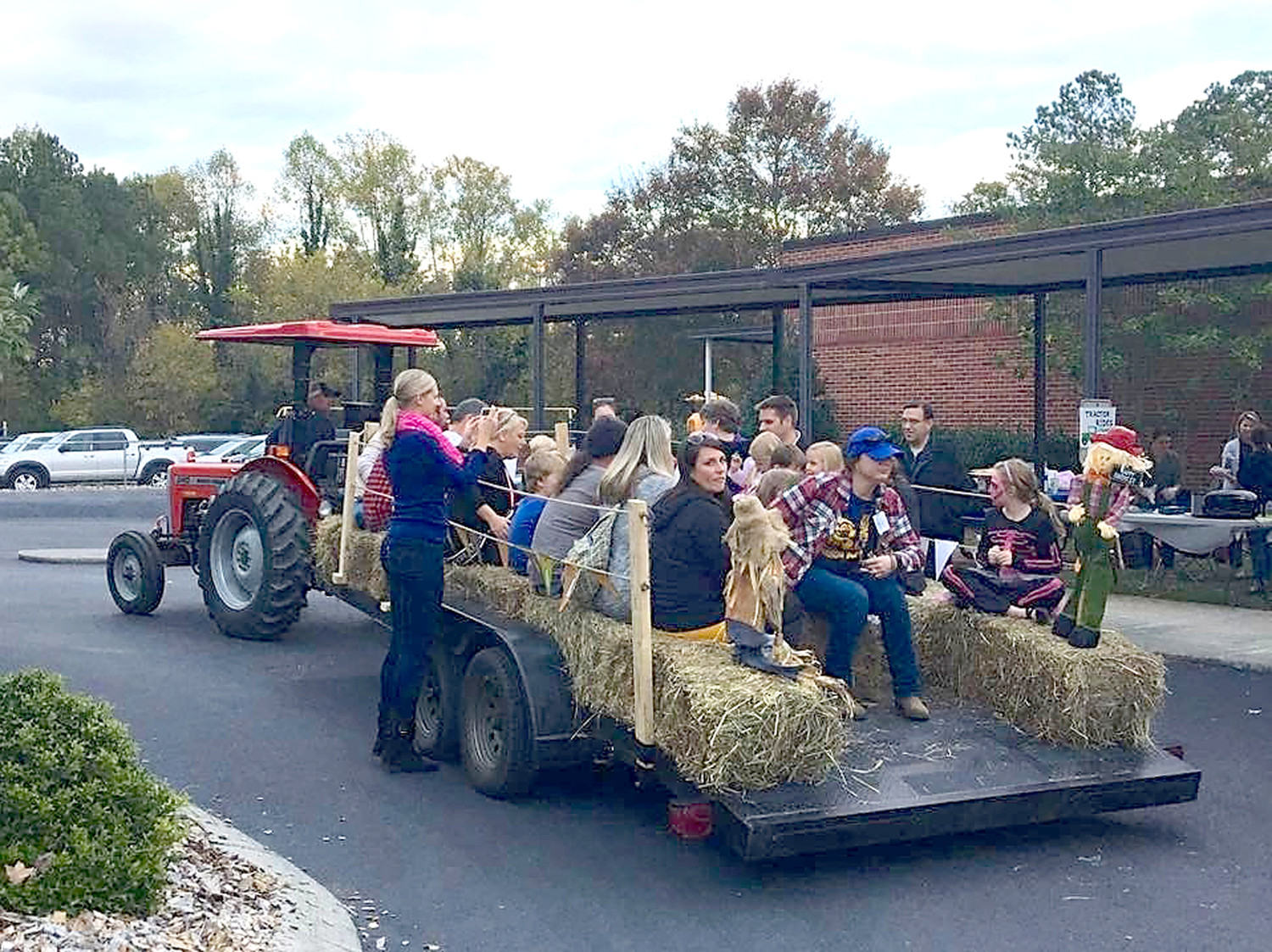 HAYRIDES provided by the Hughes family took trips from the cafeteria to the MAS Marketplace and to an area where the school's church partner, Michigan Avenue Baptist, provided free inflatables.