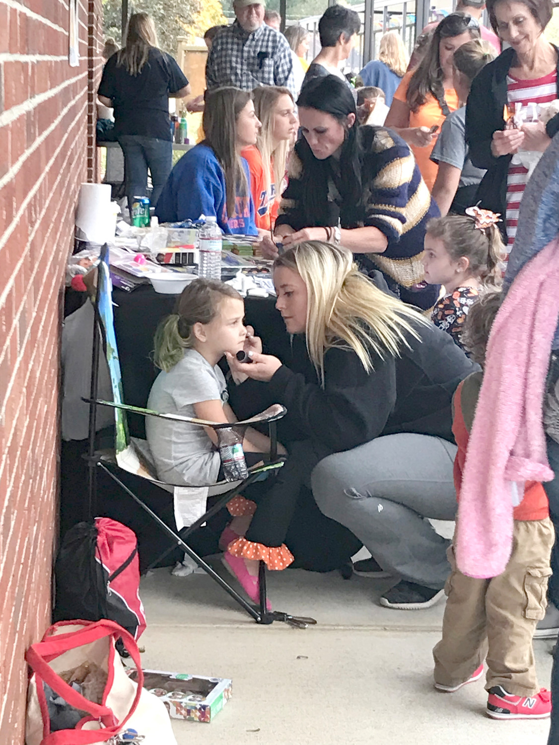 PIPER MYERS, a kindergartener at Michigan Avenue Elementary, gets her face painted during her school's recent Fall Festival.