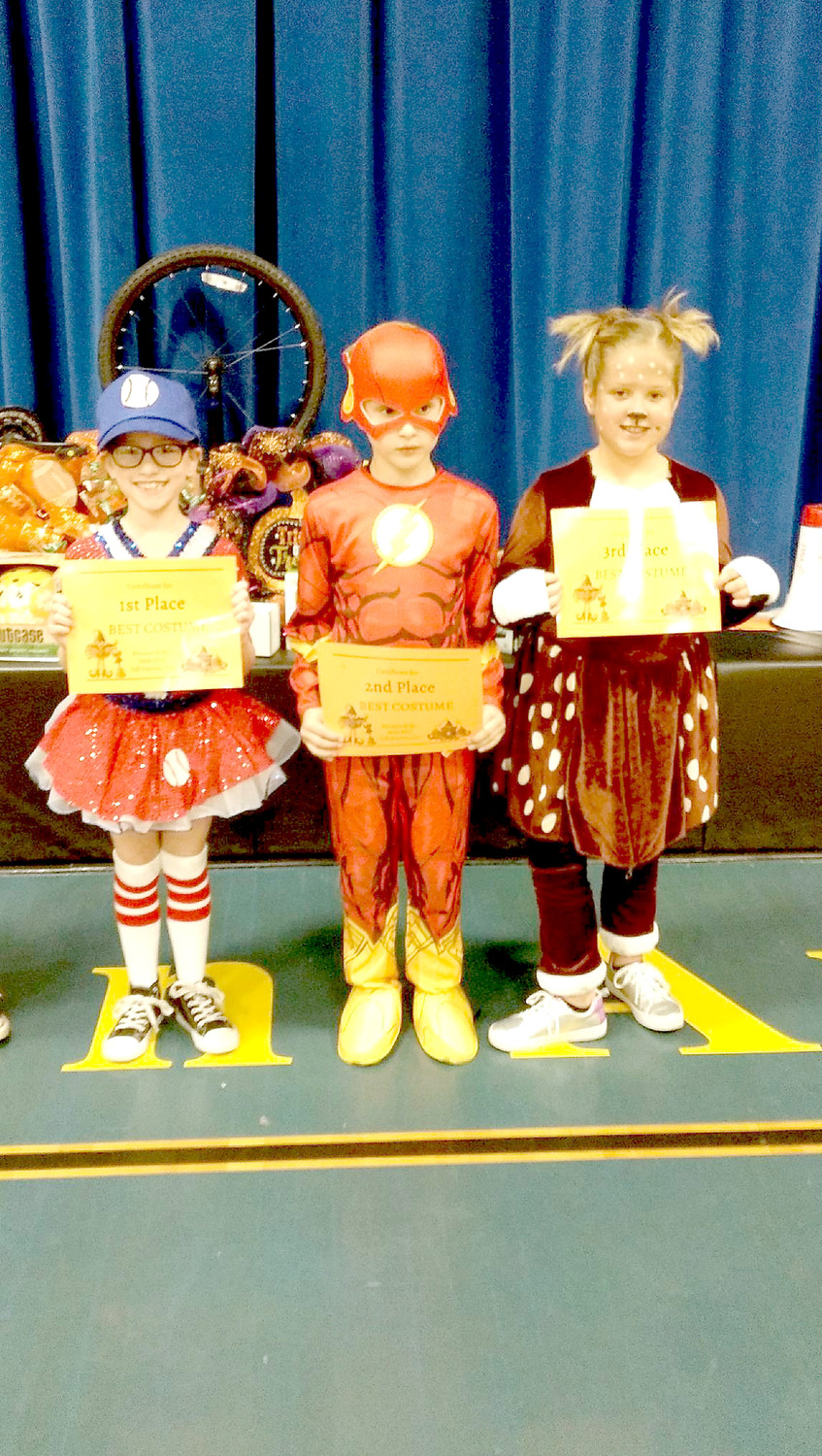 A SOFTBALL STAR, The Flash and a cute furry friend won the costume contest at the Michigan Avenue Elementary Fall Festival.
