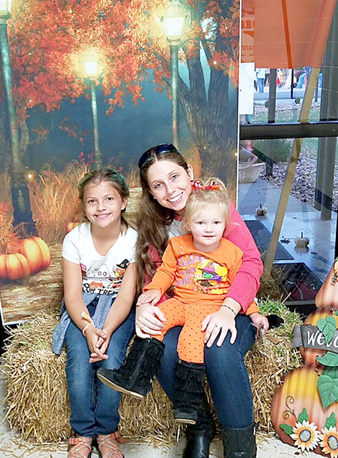 THE BURNETTE FAMILY poses for a festive fall photo during Michigan Avenue Elementary School's Fall Festival.