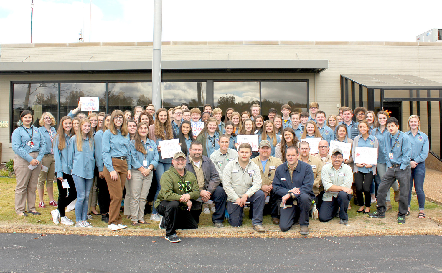 THE STUDENT GOVERNMENT ASSOCIATION of Walker Valley High School recently visited Lonza, in Charleston, to honor staff who are veterans for Veterans Day. Joining them, kneeling in front, are just nine of the veterans Lonza employs.