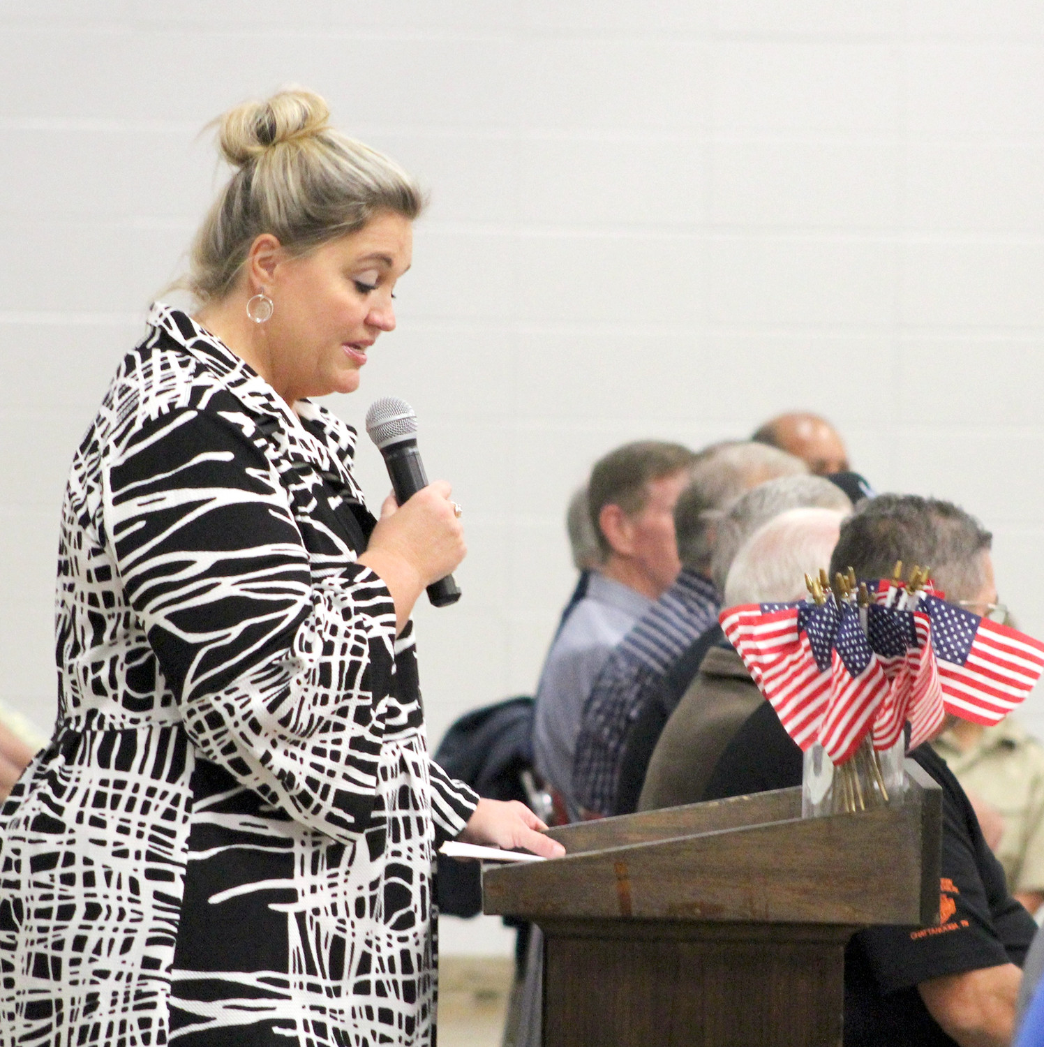 LISA EARBY, principal of E.L. Ross Elementary School, welcomes a group of veterans to the school's Veterans Day ceremony.