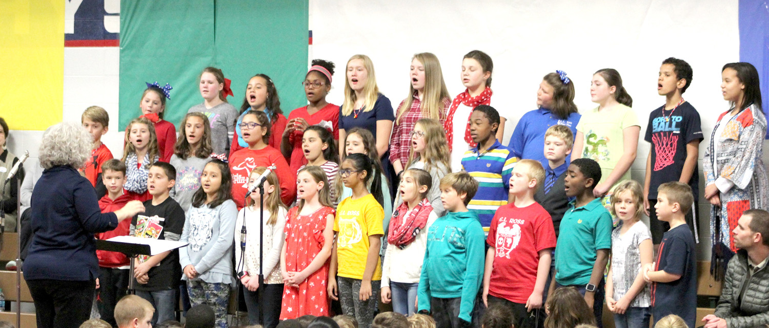 THE SHOW CHOIR of E.L. Ross Elementary School performs a patriotic song for those gathered at the school's Veterans Day ceremony.