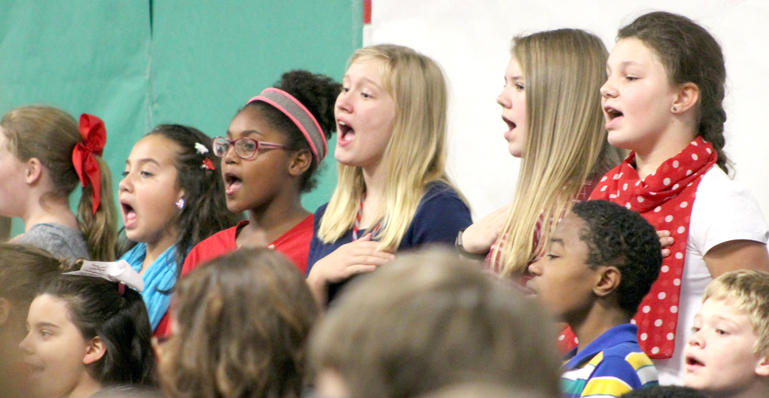 "STUDENTS in the E.L. Ross Elementary School show choir lead a singing of ""The Star-Spangled Banner"" during the school's Veterans Day event."