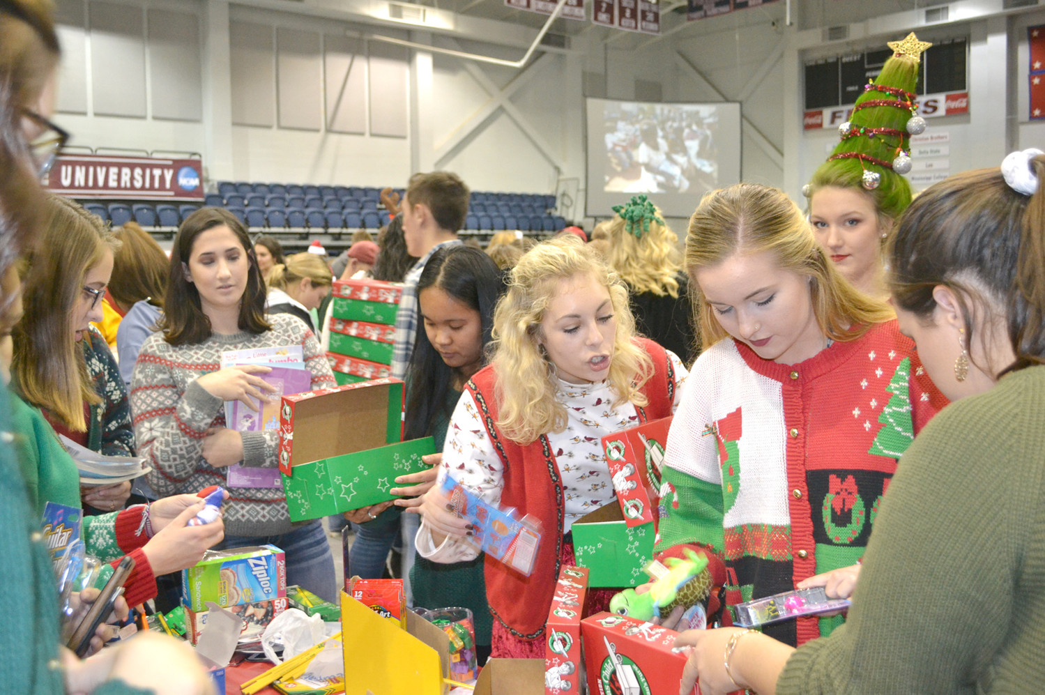 LEE UNIVERSITY students work together to create and pack boxes for Operation Christmas Child. The goal for this year is 35,000 boxes.
