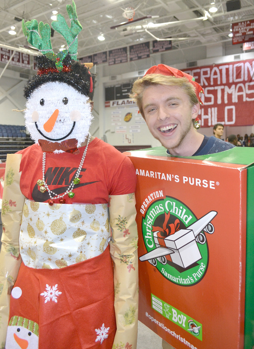 C.J. JORDAN, left, and Brennan Humphrey participated in the costume contest at Monday's Operation Christmas Child packing event at Lee University's Walker Arena.