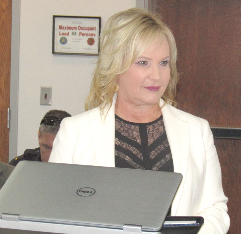 BRADLEY COUNTY MAYOR D. Gary Davis, right, and Pam Nelson of Ocoee Insurance Services addressed the Bradley County Commission on Monday to discuss the new insurance package for county employees.
