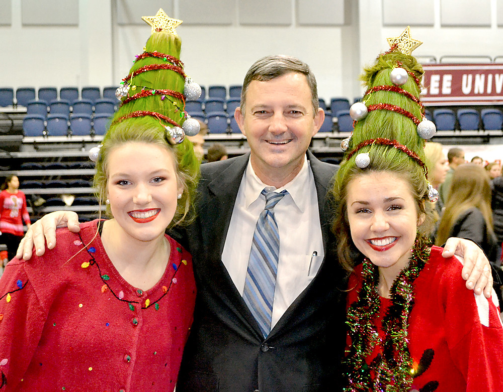 DR. BILL ESTES, dean of the Lee University College of Education, was present at an event earlier this week for Operation Christmas Child called Packnstack. With Estes were Micah Farr, left, and Tianna Haas, right, who both dressed as Christmas trees. OCC shoeboxes are still being accepted.