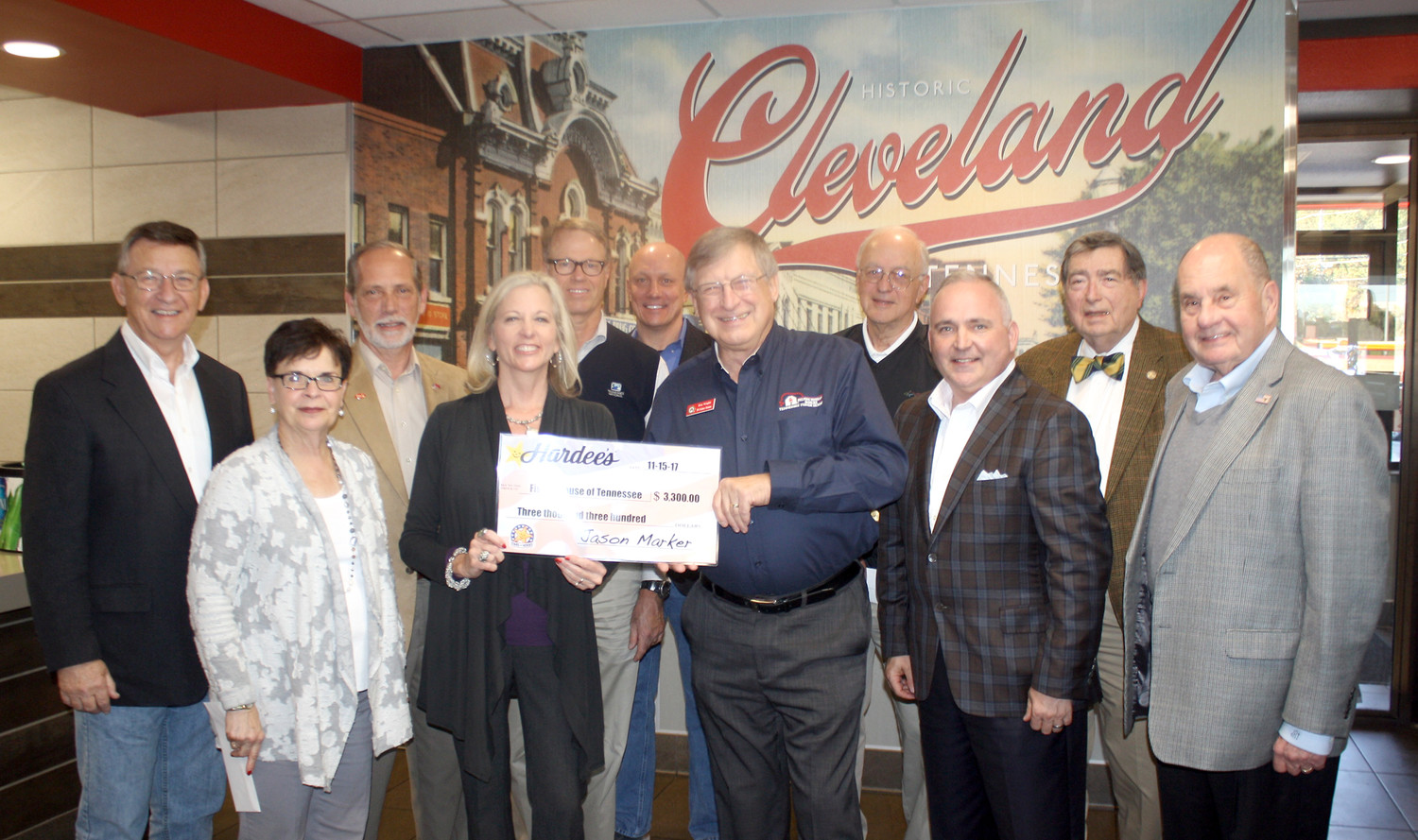 PARTICIPATING IN THURSDAY's distribution of funds from this year's Stars for Heroes by regional Hardee's restaurants were, from left, State Rep. Dan Howell, J&S Restaurant's Brenda Eckard, Bradley County Mayor D. Gary Davis, Julia Scoggins and Mark Johnson of J&S Restaurants, Veteran's Home Council Co-Chair Mark Hall, Don Wright of the Tennessee Fisher House, Council Co-Chair Sid Heidel, State Rep. Kevin Brooks, Larry McDaris of the Bradley County Veterans Affairs Office, and Cleveland Mayor Tom Rowland.