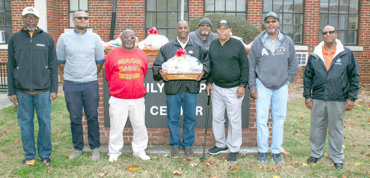 THE 100 BLACK MEN of Bradley County began an annual tradition of delivering Thanksgiving food baskets to Cleveland area families on Saturday. Following their monthly meeting at the Family Support Center, several members headed out to deliver a basket to a chosen family. From left are Mike Benson, Tony Eubanks, Alphonso Martin, Jonathan Porter (president), Don Humes, Oscar Kelley (vice president), Ralph White and Avery Johnson.