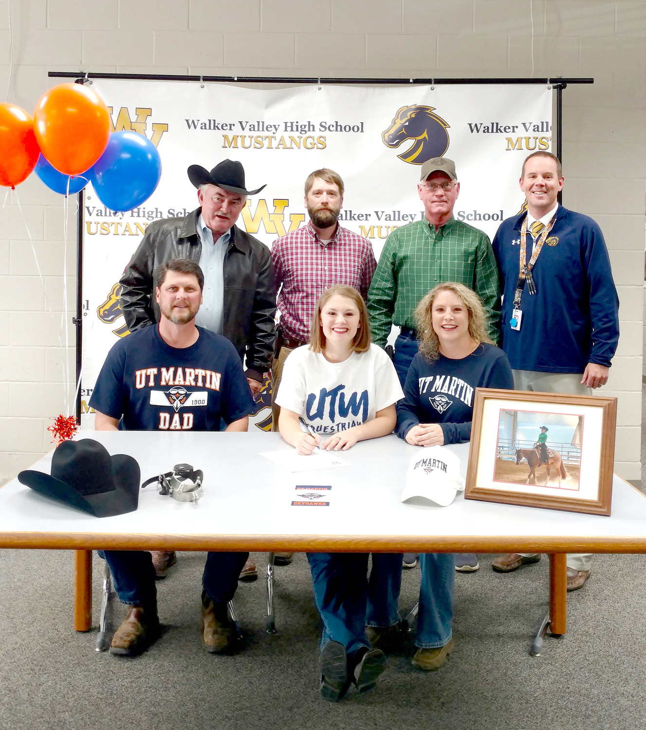WALKER VALLEY SENIOR Kyra Petty  signed an equestrian scholarship with the University of Tennessee at Martin. Seated, from left, are Brian Petty, father; Kyra Petty; and Sarah Petty, mother. Standing are Roger Elder, IEA coach; Jason Kincaid, WVHS; Tom Green, trainer and coach; and Denny Collins, WVHS assistant principal.