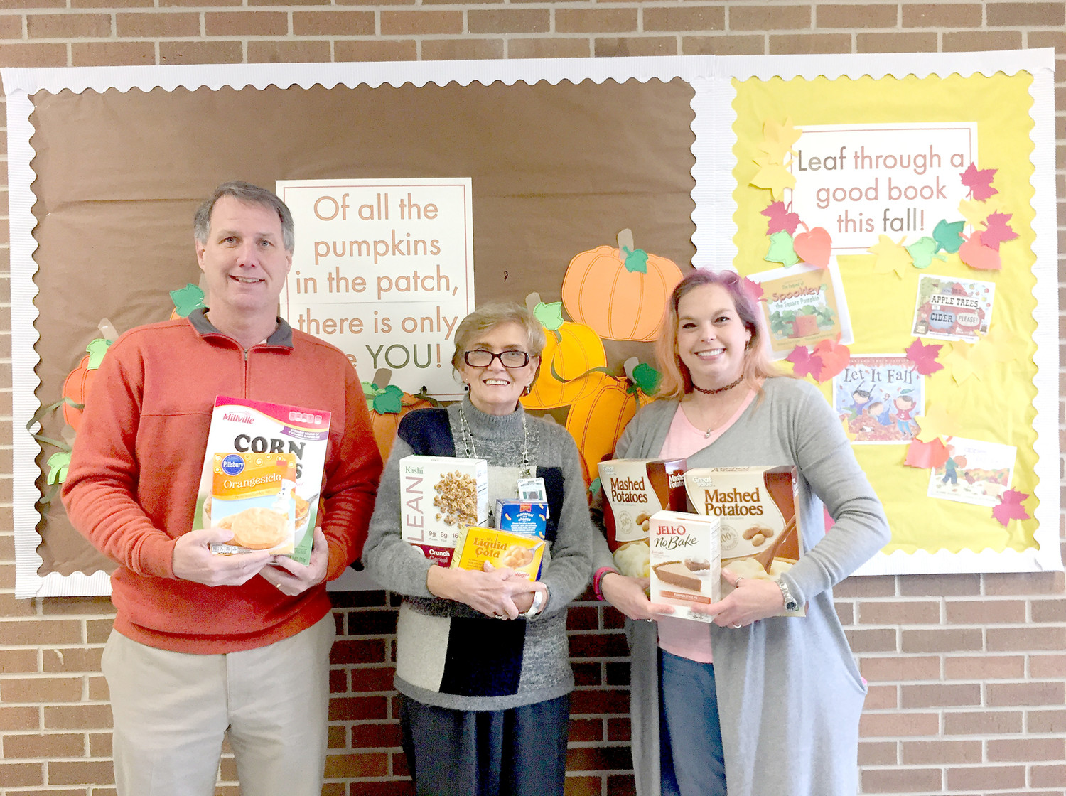 YATES Primary School collected food to help their BEST Partner, Wesley Memorial United Methodist Church, during the holiday season.  From left are Principal Mike Collier, Sandy Miller and Wesley's Amy Mott.