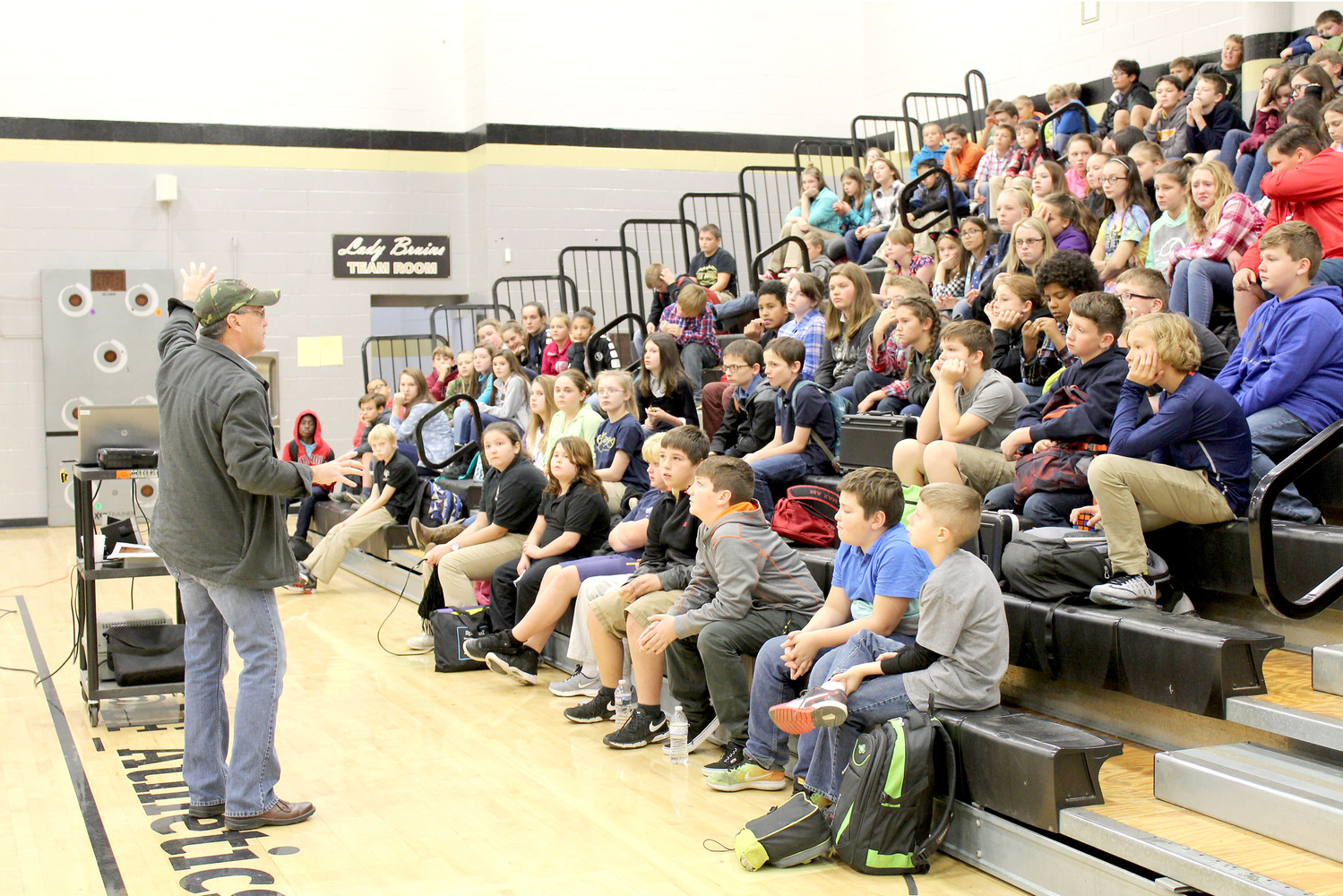 STUDENTS at Lake Forest Middle School listen Scott Elam, board chairman for The Bridge, as he gives shares a presentation about the dangers of drug use.