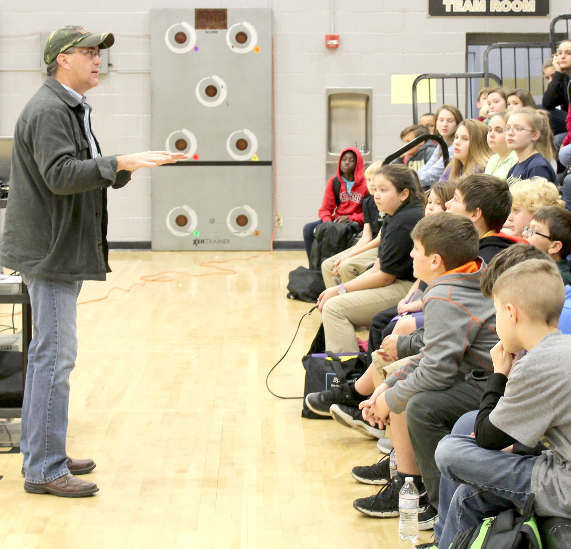SCOTT ELAM, board chairman for The Bridge, makes a point about avoiding using other people's prescription medications while speaking at Lake Forest Middle School.