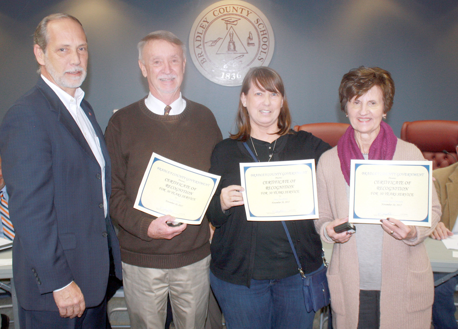 BRADLEY COUNTY MAYOR D. Gary Davis, left, recognized three county employees with recognition for 30 years of service, during Monday's Commission meeting. The three employees included Gary Conners, Dina Swafford and Joan Owenby.