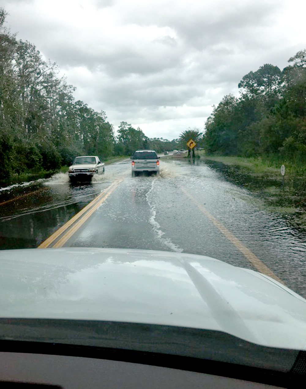 VEHICLES WERE driving cautiously along this flooded roadway in Naples, Fla., as Hurricane Irma passed through the area in September.