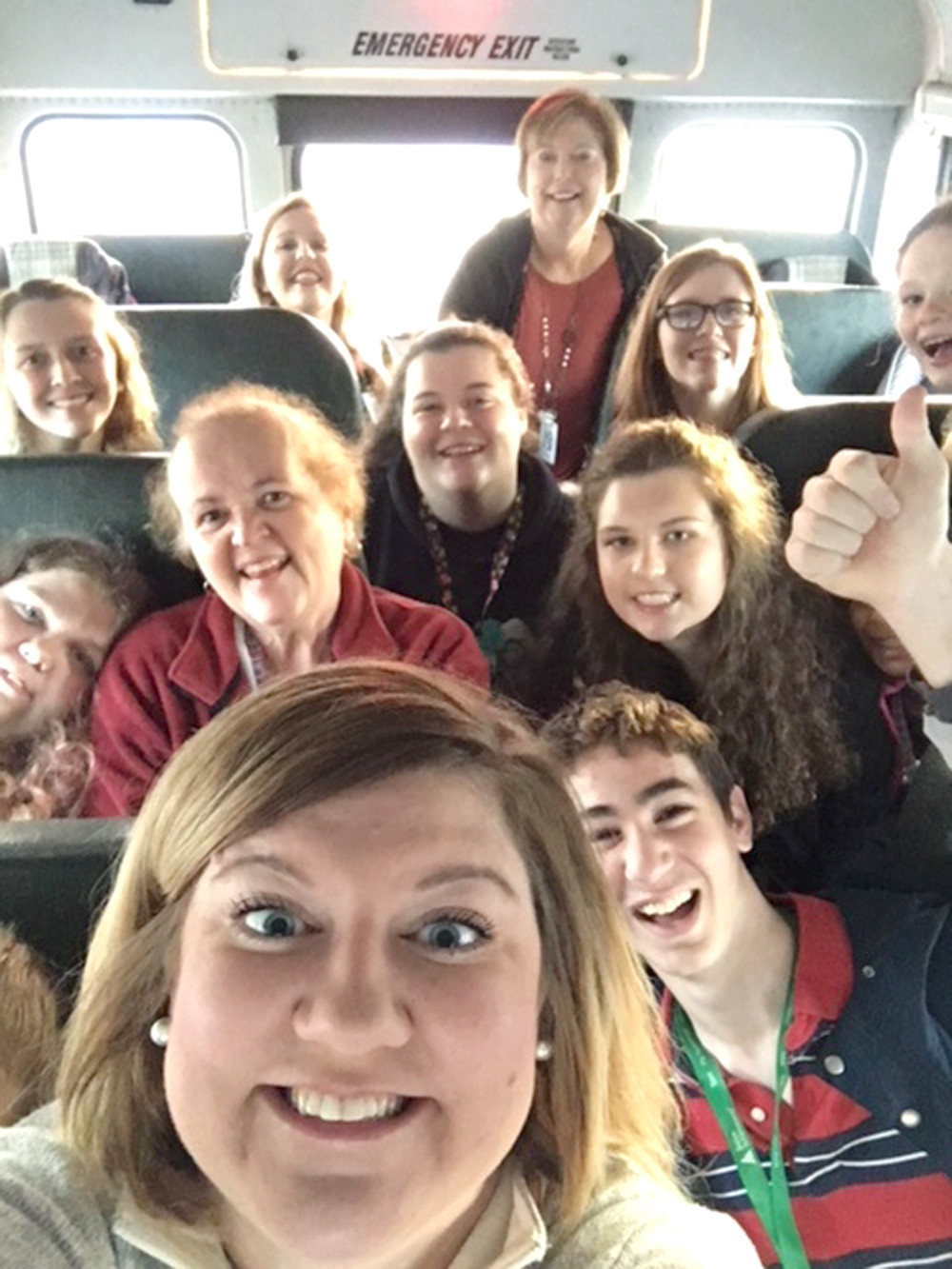 "JADE MORGAN, an inclusion teacher at Walker Valley High School, takes a ""selfie"" with teacher Pam Earnest and their students as they embark on a special field trip."