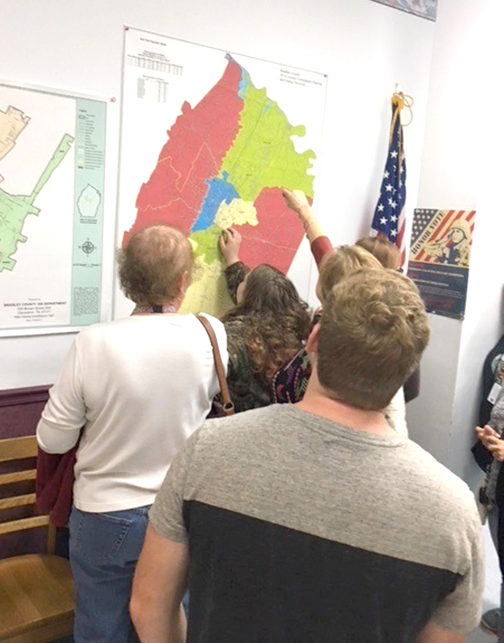 STUDENTS from Walker Valley High School find their voting districts on a map while visiting the Bradley County Election Commission.