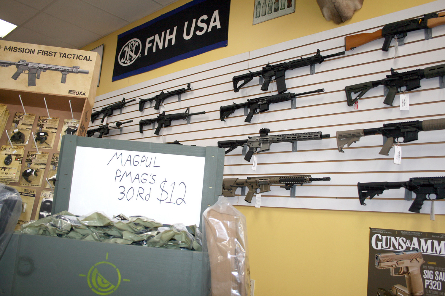 A WIDE VARIETY of firearms are displayed on the wall of Posey's Gun and Pawn shop on Keith Street. Business has increased recently with news of multiple tragedies, debates on gun control, and people looking for protection options.