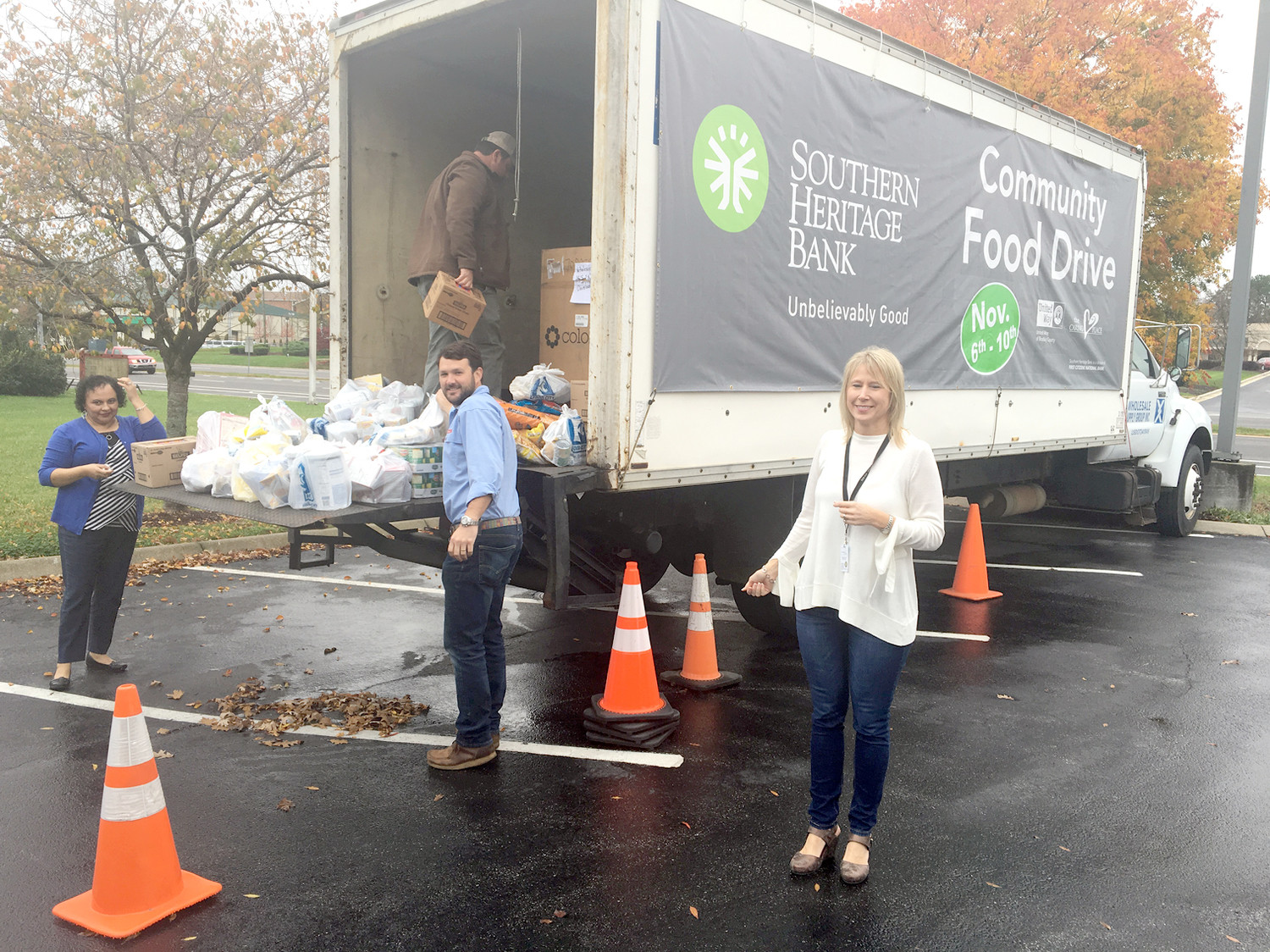 CLEVELAND UTILITIES  food drive donations are delivered by Maribel Ware, Paul Harvey and Deanna Hitch.