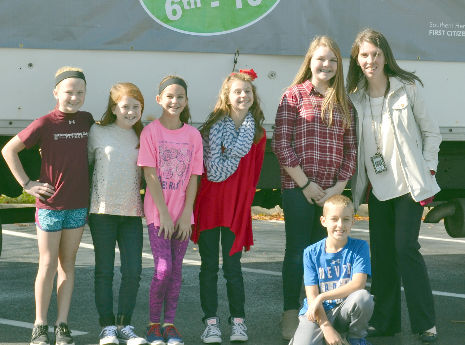 E.L. ROSS ELEMENTARY donations to the Southern Heritage Food Drive were delivered by, from left, Ashlyn Robbins, Lily Smith, Aspen Ownby, Emma Claire Smith, Natalie Clark, Andrew Miolen and Dana Storey.
