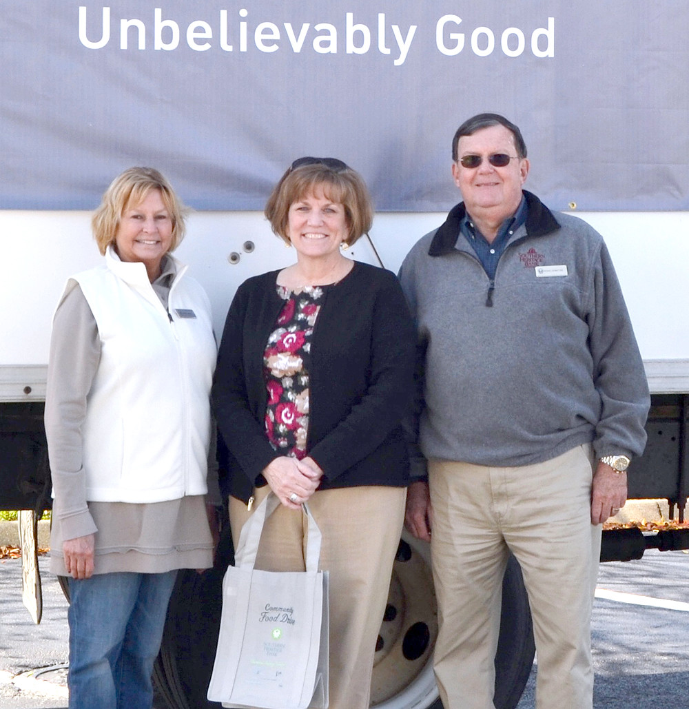 OLIN CORPORATION  participated in the food drive sponsored by Southern Heritage Bank. From left are  Denise DeArmond, Lori Wilson and Steve Ledbetter.