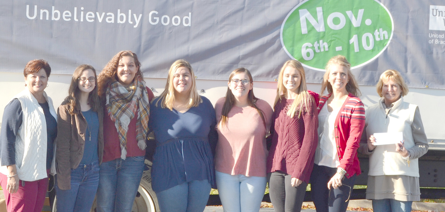 WALKER VALLEY HIGH SCHOOL students contributed to the Southern Heritage Bank Food Drive. From left are Sherry Everett, Olivia Bandy, Kaitlyn Spence,  Taylor Bullington, Mary Beth Canida, Taylor Ellis, Lindsey McChesney, and Denise DeArmond.