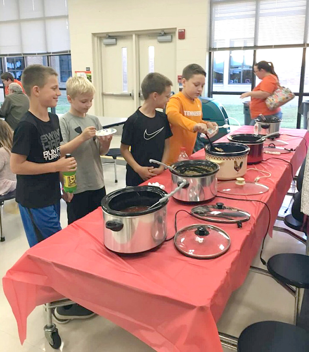 FIFTH-GRADE BOYS try out some of the chili served at Park View Elementary School's recent literacy night. Families enjoyed activities and food centered around a camping theme.
