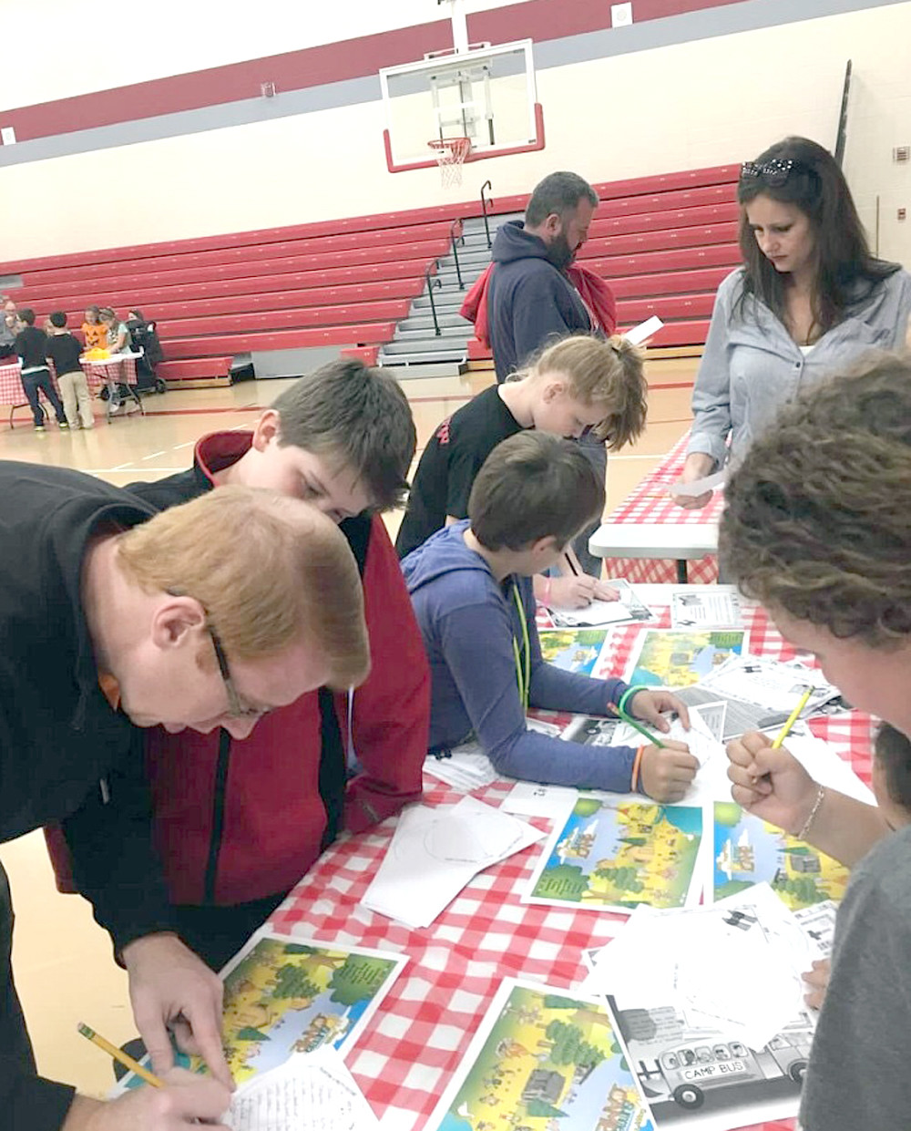 "STUDENTS complete a scavenger hunt by solving a secret code during an event at Park View Elementary. The theme was ""A Camp-in with Reading,"" and there were several camping-themed activities."