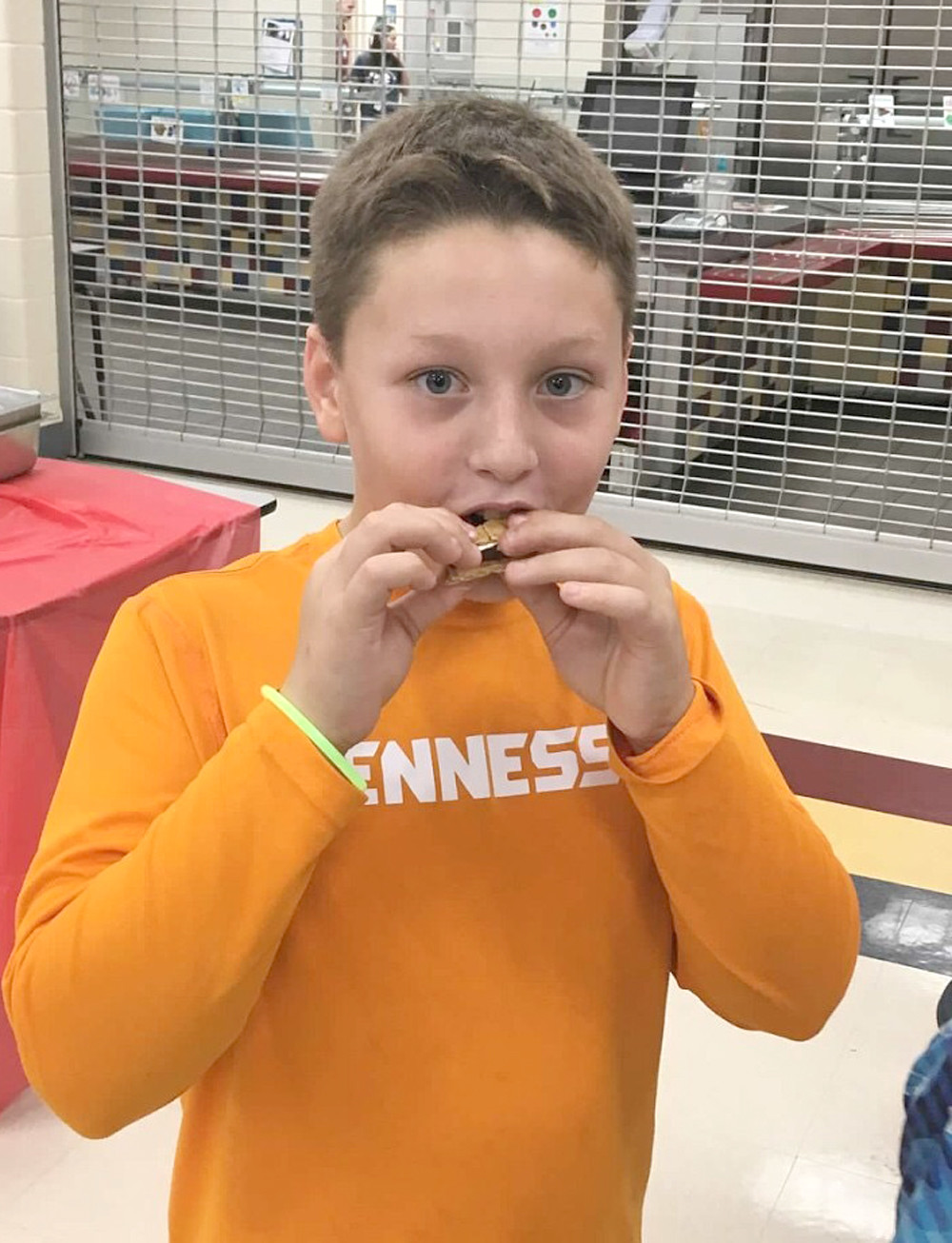 "TATE ROUNTREE, a fifth-grader at Park View Elementary, pays a visit to the s'mores table during the school's "" A Camp-in with Reading"" event."