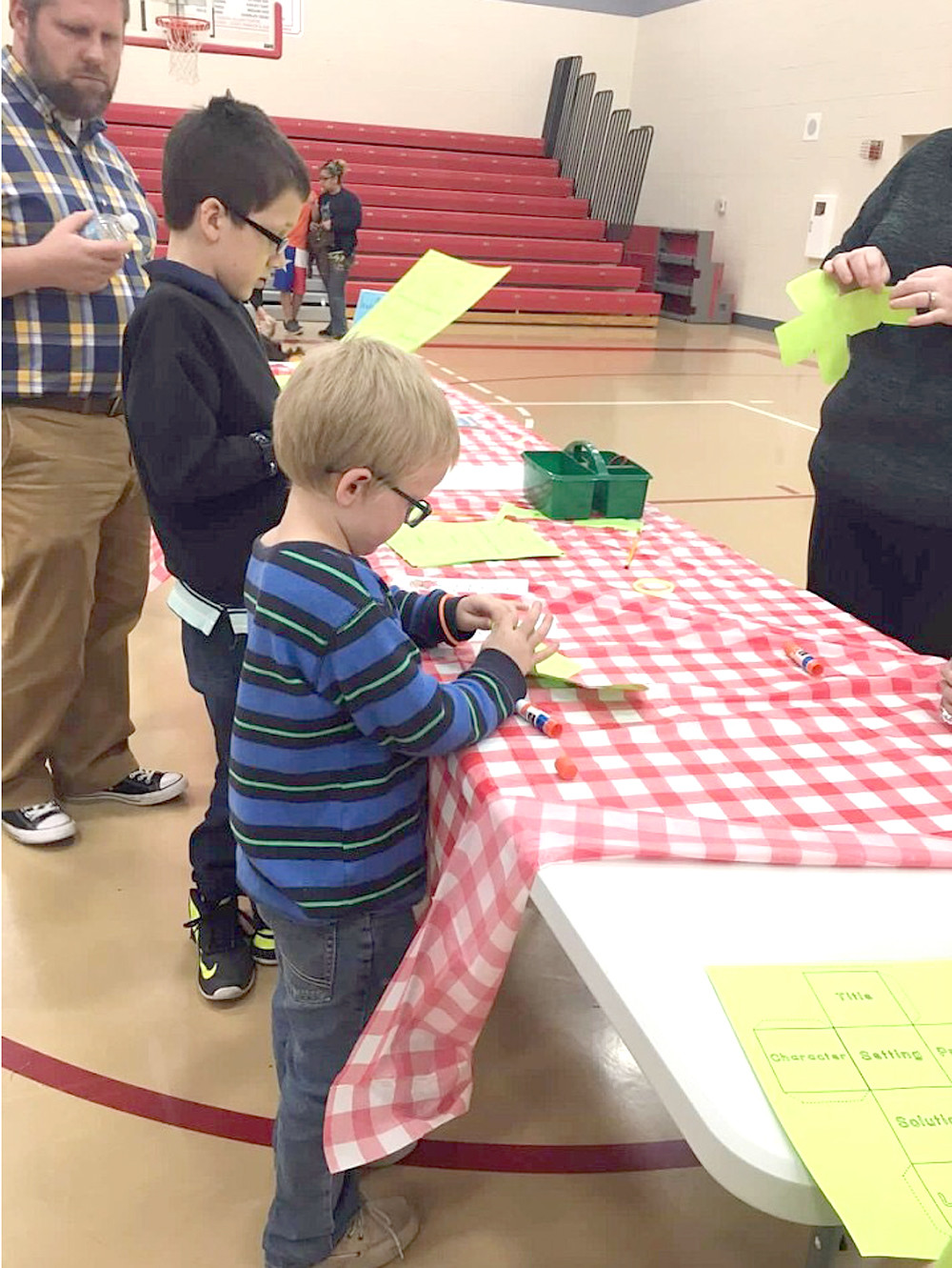 "ROCKY JOHNSON, a first-grader at Park View Elementary, creates a ""storytelling cube"" during a school literacy night. Activities were centered around camping traditions, including storytelling."