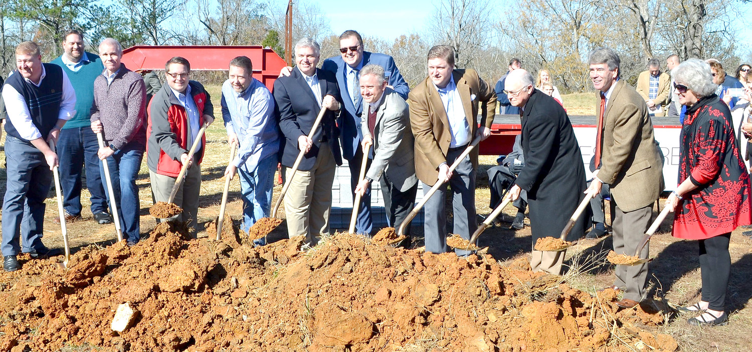CHURCH AND PASTOR COUNCIL members participated Sunday in the groundbreaking for the new site of Westmore Church of God. From left are Travis Taylor, Josh Black, Cameron Fisher, Adam Lewis, Jeff Sherrill, Barry Ray, Senior Pastor Kelvin Page, Bill Green, Daniel Clanton, Douglas LeRoy, Bill Winters and Paulette Lewis.