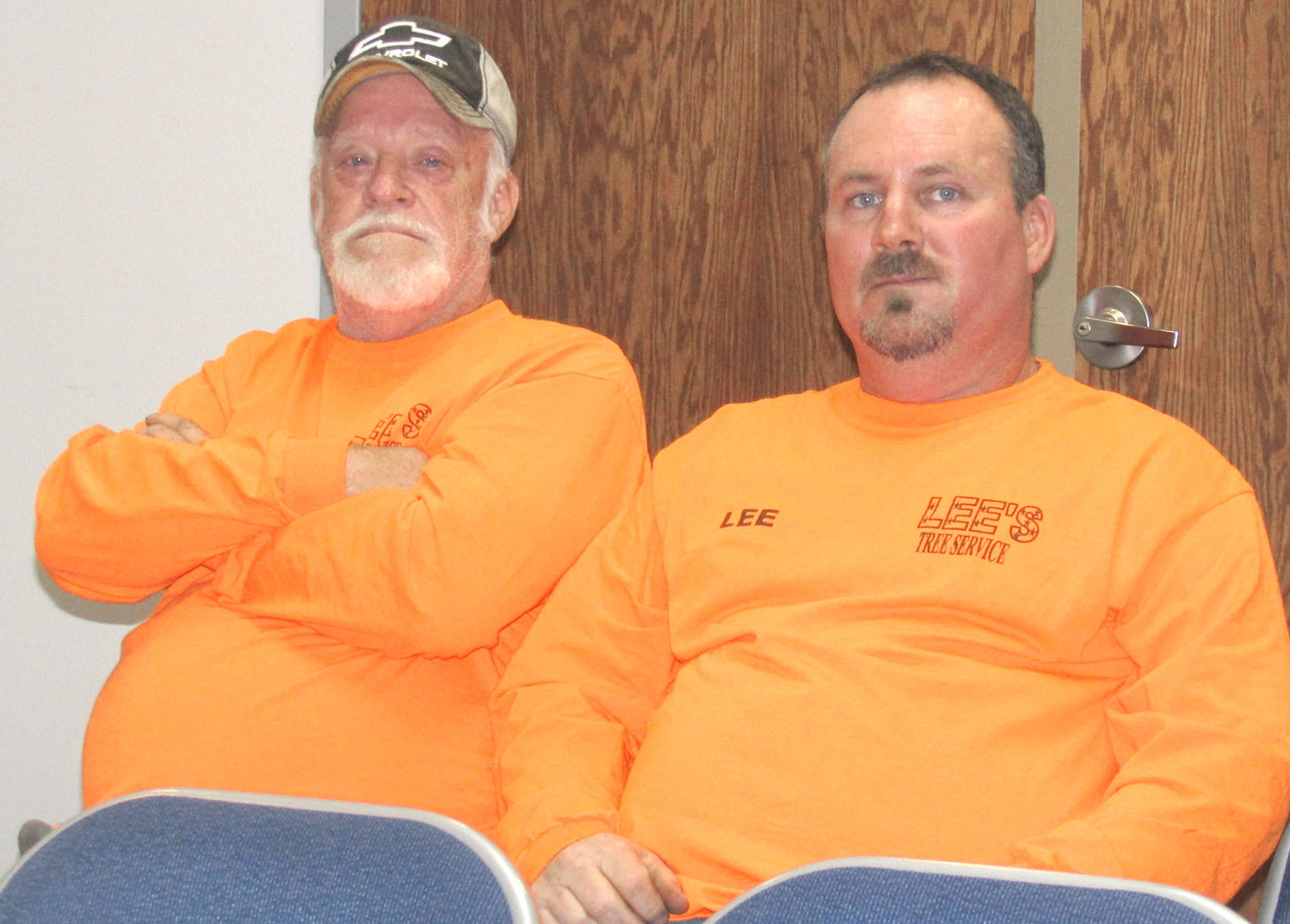 LEE GOODMAN, right, owner of Lee's Tree Service, and employee Ray Earwood, left, were recognized by the Bradley County Commission Monday for their help in cleaning up an eyesore on Highway 64.