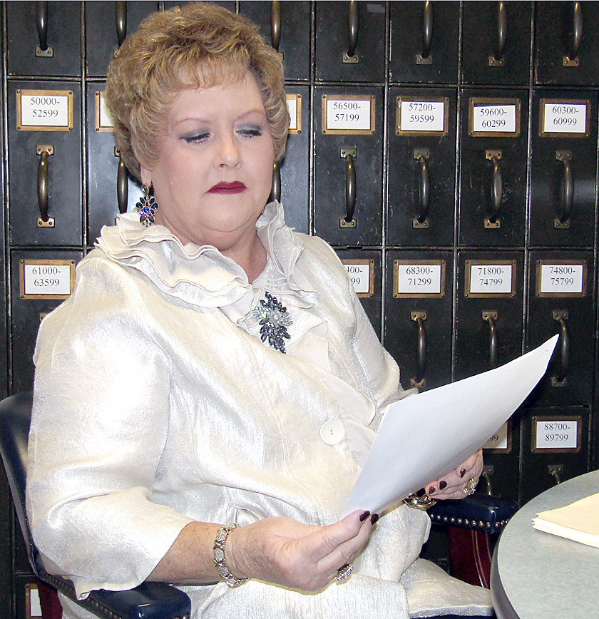 CIRCUIT COURT CLERK Gayla Miller reads the report from 10th District Attorney General Steve Crump stating the TBI found no evidence for any of the allegations of wrongdoing made against her.