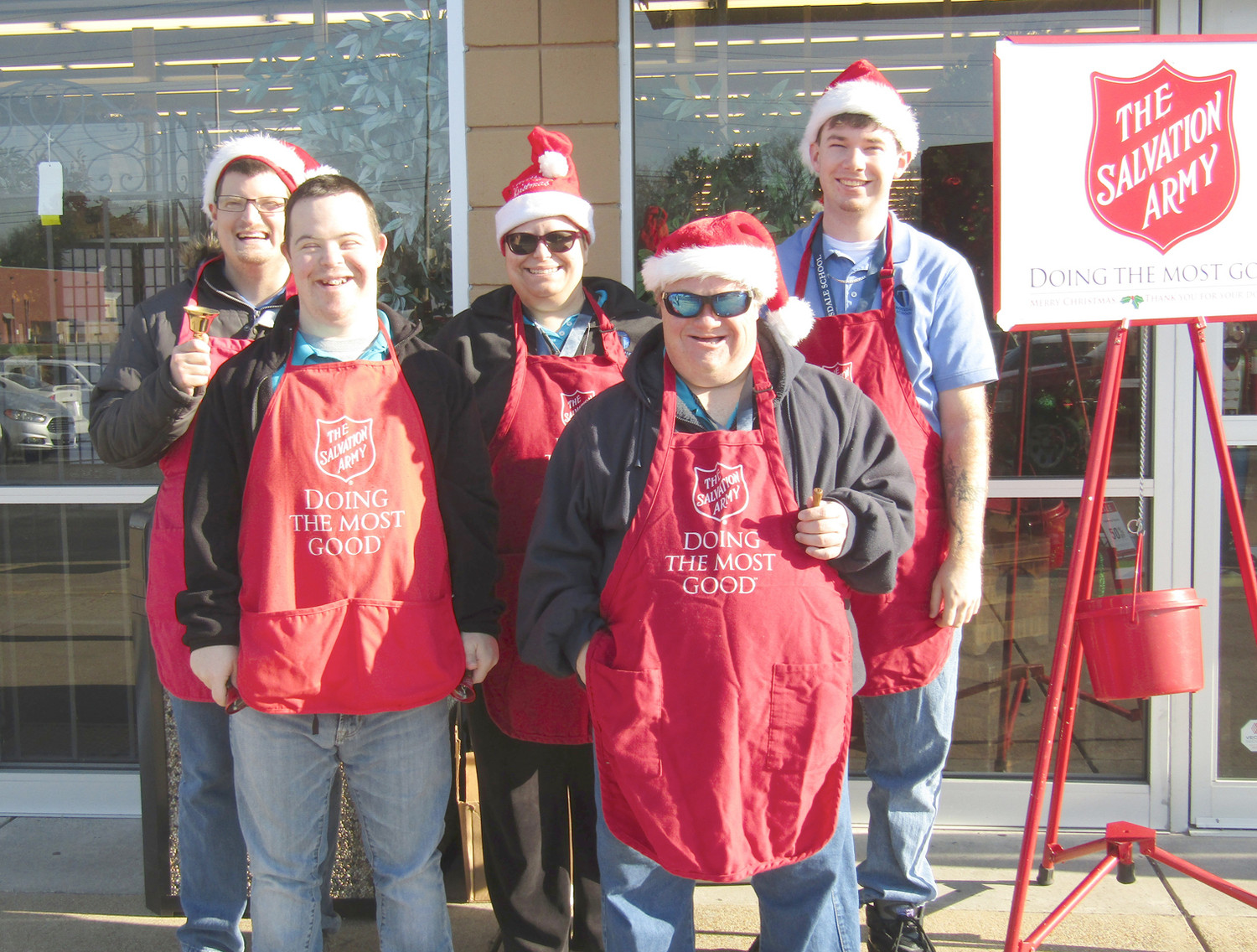 rousdale School students donned their Christmas best Wednesday morning, as they helped fill the Salvation Army kettles in front of Hobby Lobby. In front are Brady Hammand and Chris White. In back are Chris Stamey, Jessica McFarland and Eric Peterson.