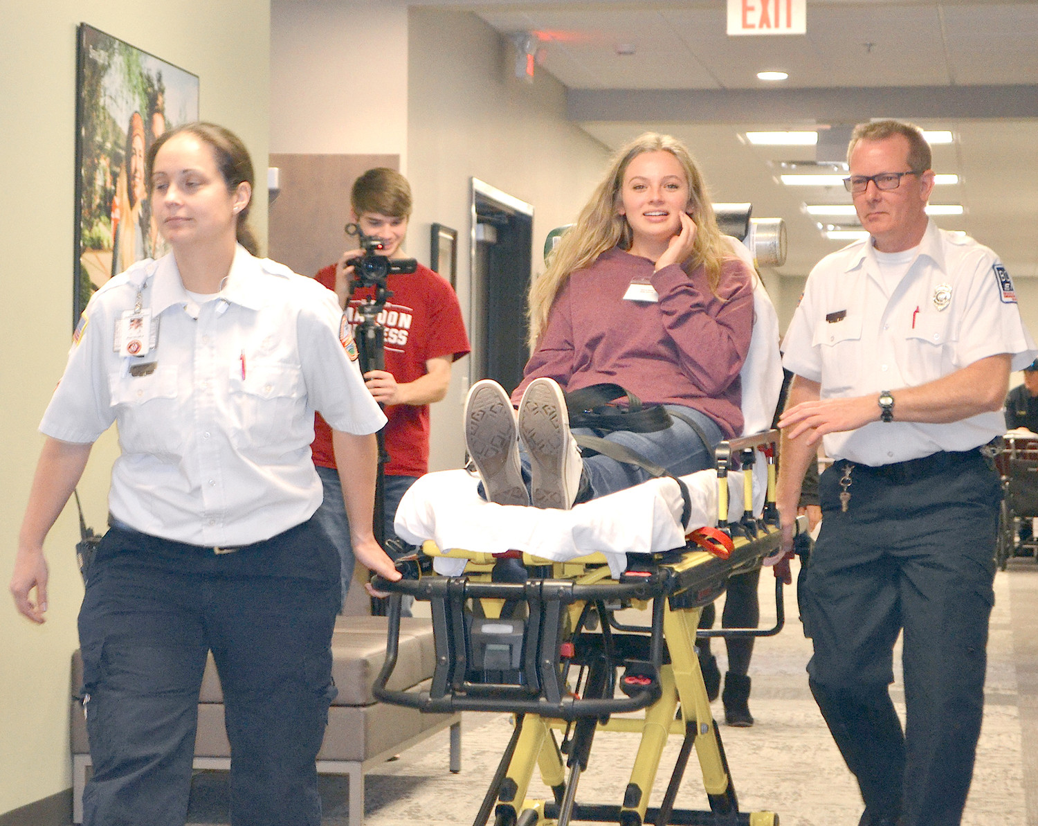 LEE UNIVERSITY STUDENT Kylee Hormann is transported by emergency personnel Megan Hall and Tim Plemons to the make-shift emergency room during the mass casualty drill held Wednesday at the university's School of Nursing.