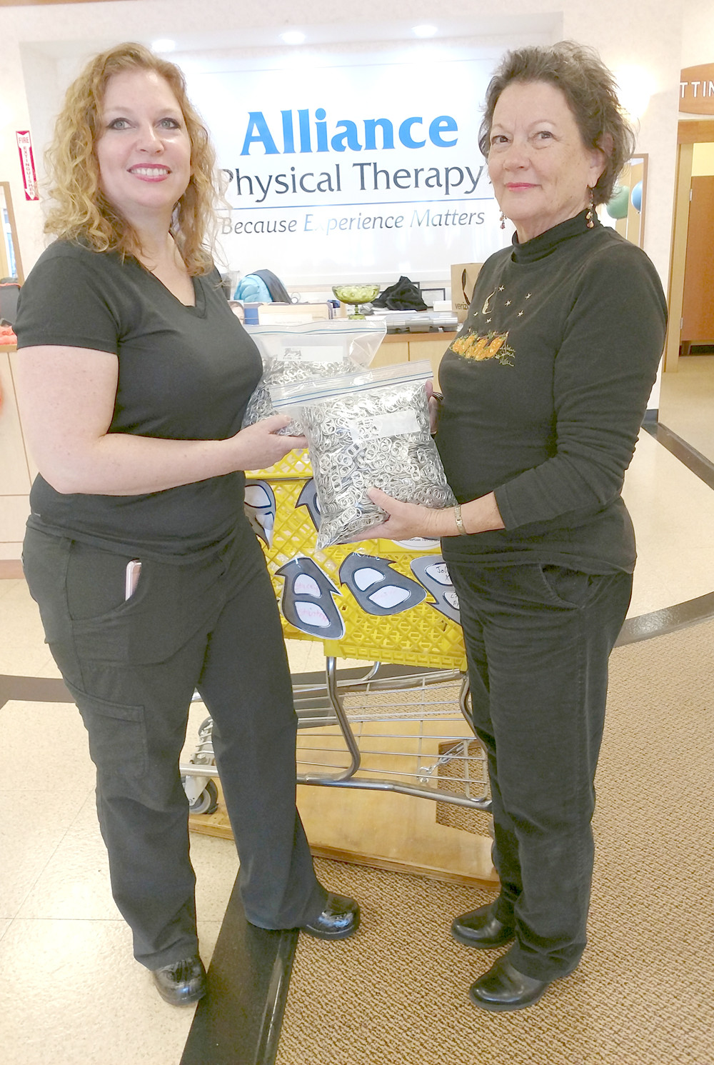 Dawn Morgan PT, DPT of Alliance Physical Therapy, accepts 69 ounces of pull tabs from Brenda Derryberry of the Prospectors Family and Community Education Club for the Ronald McDonald House in Chattanooga. Recently, Alliance Physical Service delivered more than 40 pounds of pull tabs and encourages the community to continue making donations at their convenient location at 283 Paul Huff Parkway N.W. in Cleveland. At this time they are also collecting new and unwrapped Toys for Tots as another community project.